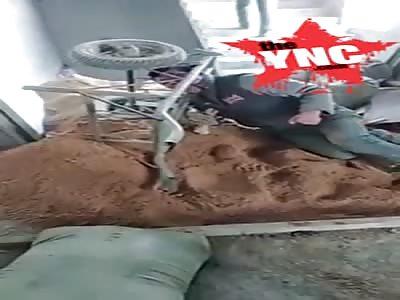 mans head  stuck in a wheelbarrow in guangdong