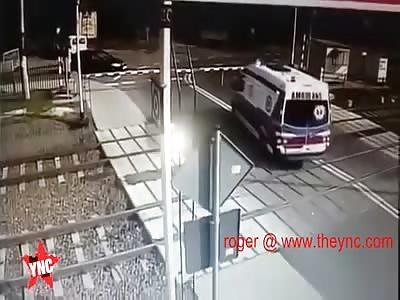 Polish Ambulance Driver Gets Vehicle Stuck on Railway Crossing, Train Plows Them