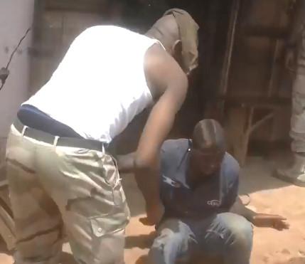 Cameroonian Troops beating a Prisoner
