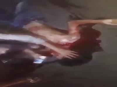Woman cries while boyfriend lies dead in pool of blood