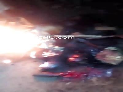 Thugs roasting on an open fire