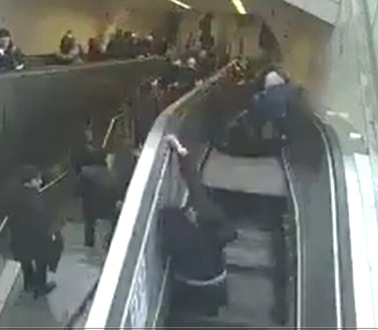 Man Gets Sucked inside an Escalator