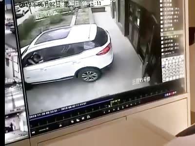 Car Reverses into Kid