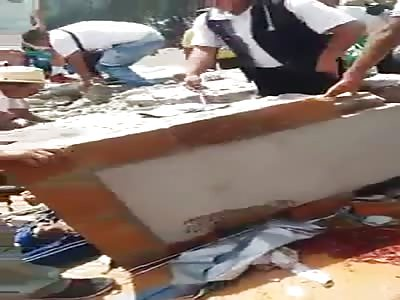 body buried beneath a huge concrete block
