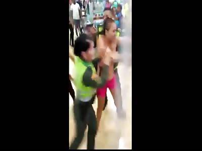 Vebezuela woman stripped naked in shop