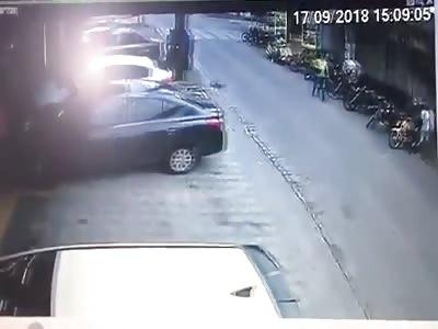 Car wipes out a biker and pedestrian in Brazil.