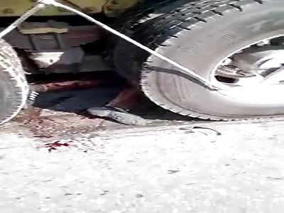 Dead person under truck