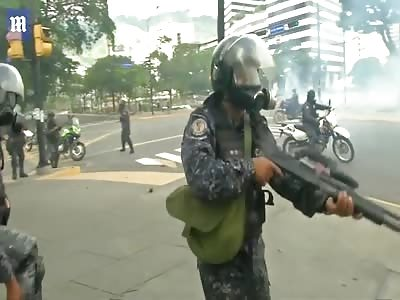 Venezuelan police fire tear gas on anti-Maduro protesters