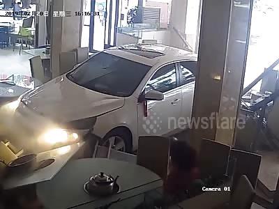 Nervous newbie driver plunges car into restaurant...