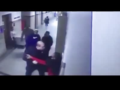 Massachusetts Police Officer Forcibly Arrests Student in School Hallwa