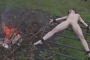 SLAVE FUCKED OVER A CAMPFIRE