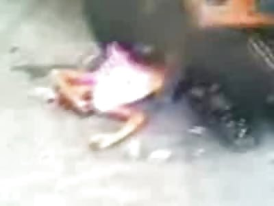 Hemmed Up Girl in Pink Shirt Stuck under a Truck, Friend Died as Well