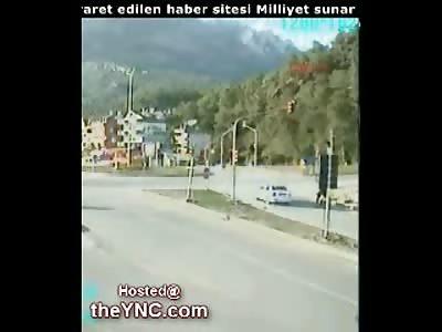 Oblivious Biker gets Flattened by a Dump Truck