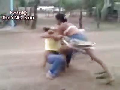 Hispanic Girl loses her Blouse and still Kicks Ass