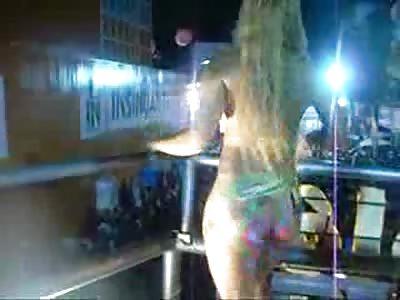 Brazilian Girl wearing Nothing but Paint Dances on a Balcony