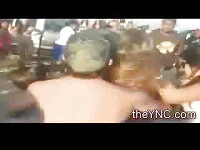 Girl loses Bikini Top in Beach Fight and a Guy gets KO'd