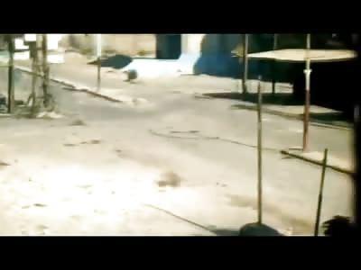 FSA Cameraman Captures his Comrades Suicide When He Runs into a Building with a Bomb