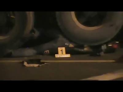 Motorcyclist Flattened under Semi's Wheels