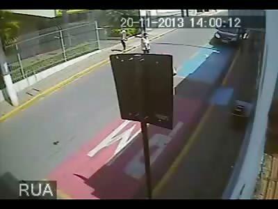 Woman Crossing the Street is Struck by Motorcyclist