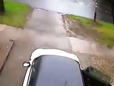 Carjacker drags woman into traffic.