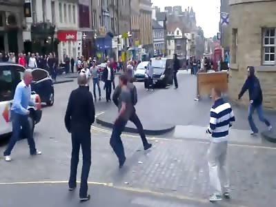British football hooligans fight in the street
