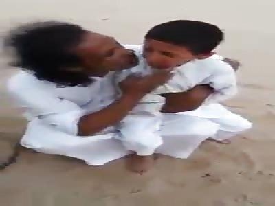 Sand niggers burn kids feet with metal stick