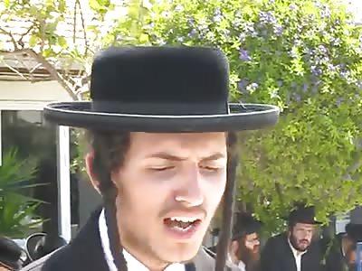 Jews Hate Woman - Swarm, Attack and Spit on Non-jewish Female Reporter