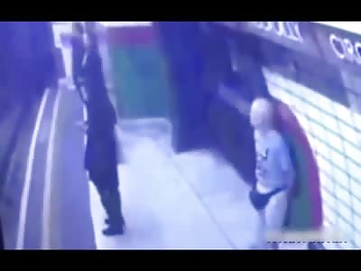 Man Pushes Muslim Woman Against Oncoming Train