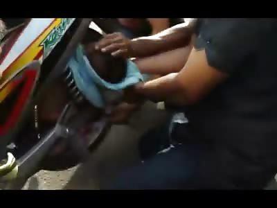 INCREDIBLE: Baby stuck in Motorcycle Wheel Spokes!!