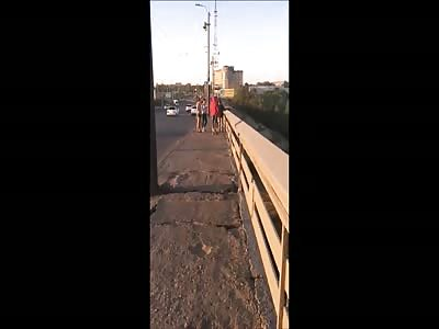 The girl was thrown off a bridge