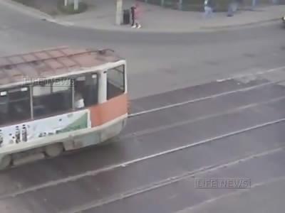 Pedestrians Horrlbly Crushed Under Tram