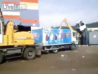 EXCAVATOR DRIVER DESTROYS TRUCK