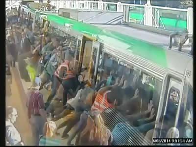 MANY PEOPLE PUSH TRAIN TO HELP