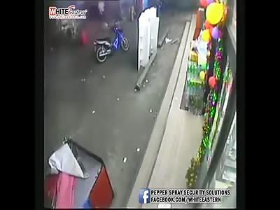 MAN BEING SLASHED OUTSIDE A SHOP