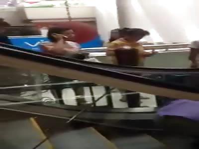SMALL CHILD STUCK ON ESCALATOR