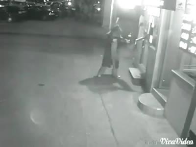AMAZING CCTV FOOTAGE OF BRAVE MAN VERSUS ARMED ROBBER