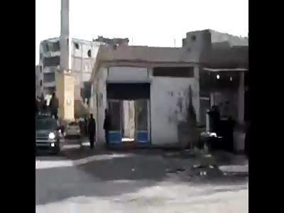 CORPSES IN A TRUCK RUNNING THROUGH DEIR EZZOR.