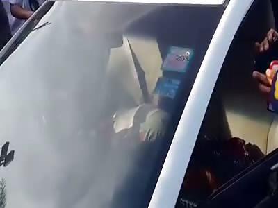 GIRL FOUND DEAD IN A CAR