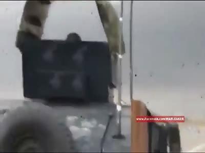 Iraqi Humvee Clears Road Of Stucked VBIED With Machine Gun Burst