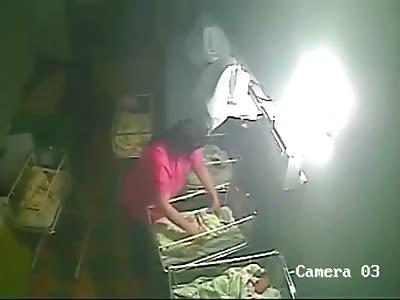Nurse viciously beating a new born baby