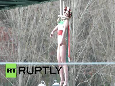Topless FEMEN 'hangs' herself on Paris bridge to protest Rouhani's visit
