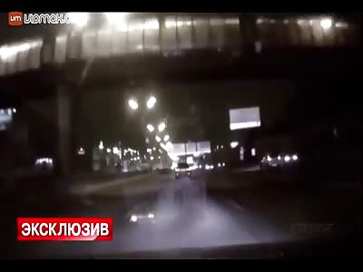 Speeding Van smashes into a concrete barrier.